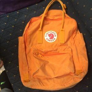 "Orange Fjallraven Kanken Classic 13"""